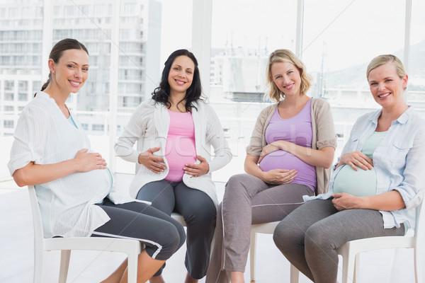 Smiling pregnant women sitting together at antenatal class Stock photo © wavebreak_media