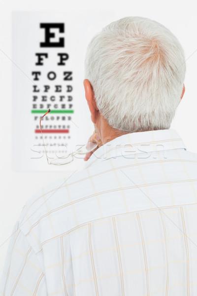 Rückansicht Senior Mann schauen Auge Tabelle Stock foto © wavebreak_media