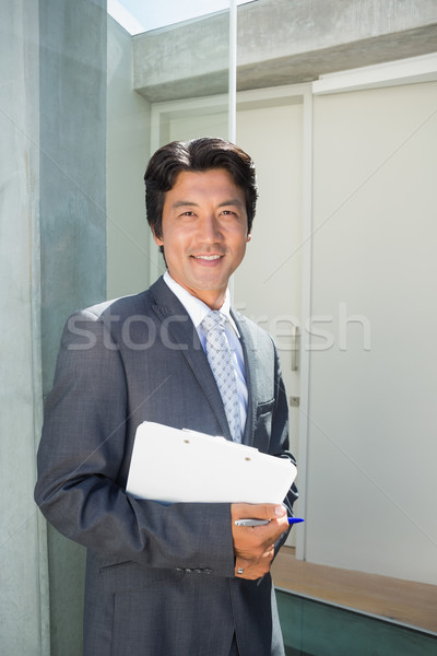 不動産業者 立って フロントドア クリップボード 外 家 ストックフォト © wavebreak_media