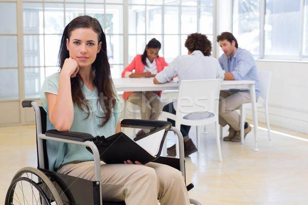 Séduisant handicapées femme d'affaires travaux souriant caméra Photo stock © wavebreak_media