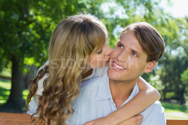 Afetuoso casal relaxante parque banco juntos Foto stock © wavebreak_media