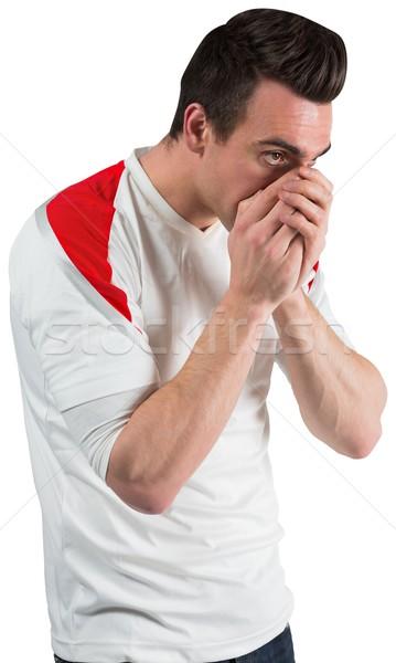 Rozczarowany piłka nożna fan patrząc w dół biały sportu Zdjęcia stock © wavebreak_media