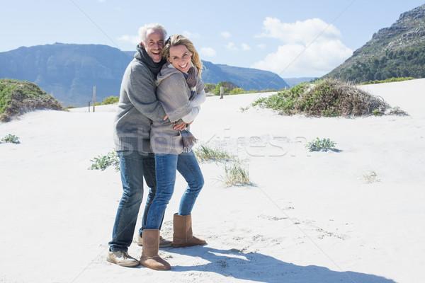 улыбаясь пару пляж теплая одежда ярко Сток-фото © wavebreak_media