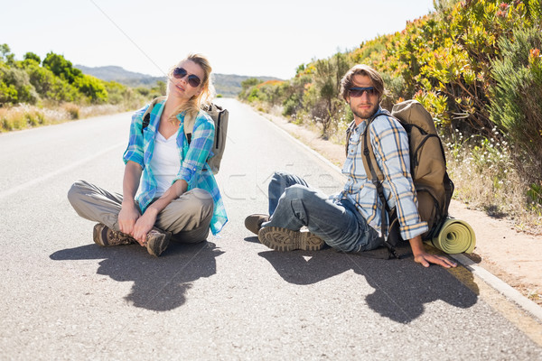 Attractive couple sitting on the road hitch hiking Stock photo © wavebreak_media