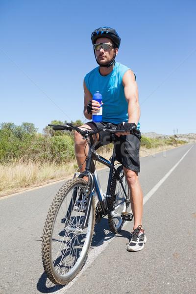 Jóképű kerékpáros elvesz törik bicikli napos idő Stock fotó © wavebreak_media