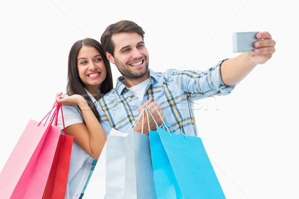 Attractive young couple with shopping bags taking a selfie Stock photo © wavebreak_media