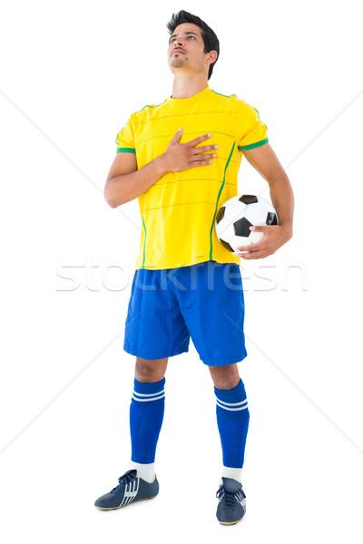 Futballista citromsárga labda hallgat himnusz fehér Stock fotó © wavebreak_media