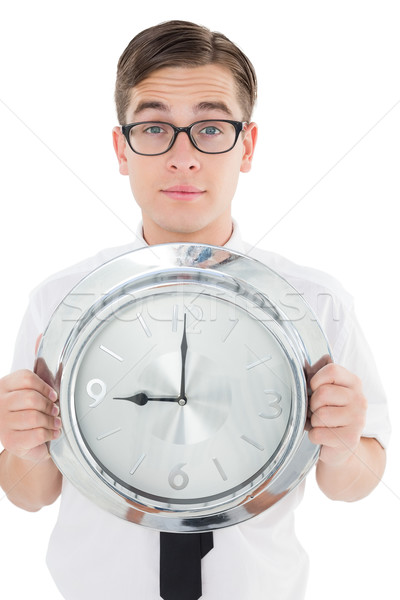 Nerdy businessman showing clock to camera Stock photo © wavebreak_media