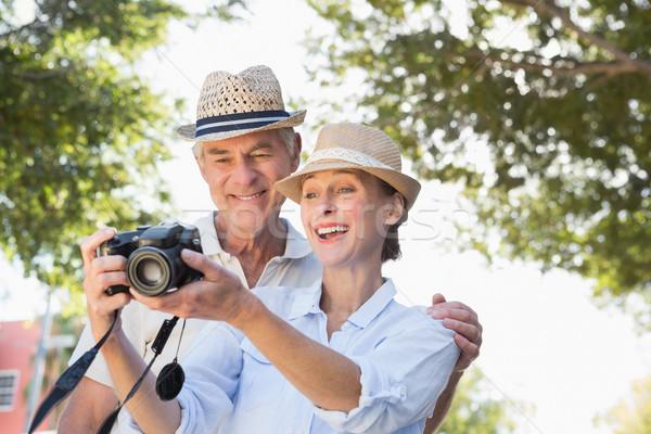 Happy senior couple looking at their camera Stock photo © wavebreak_media