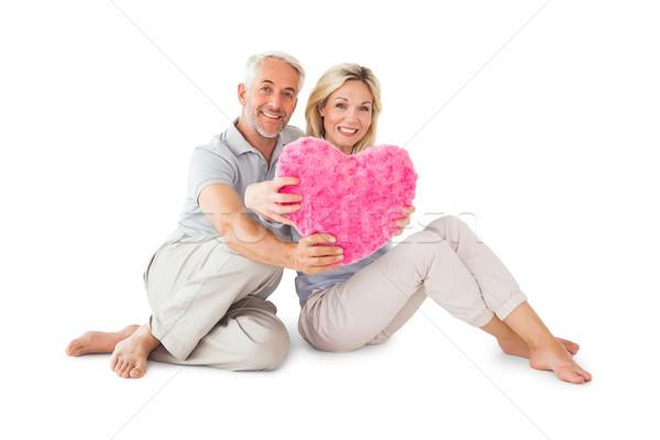 счастливым пару сидят сердце подушкой Сток-фото © wavebreak_media