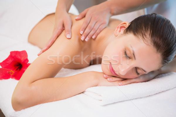 Attractive woman receiving shoulder massage at spa center Stock photo © wavebreak_media