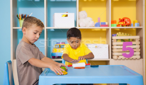 Cute little boys playing with modelling clay in classroom Stock photo © wavebreak_media