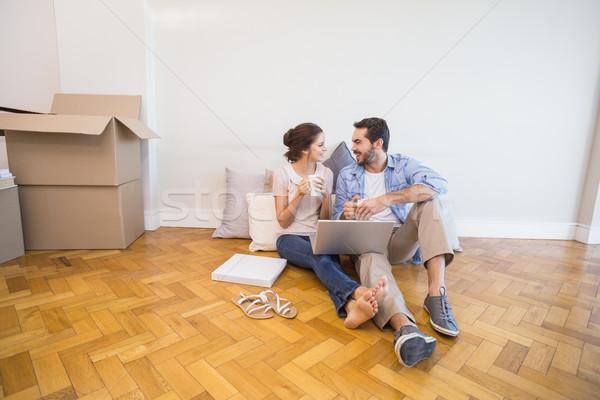 Cute couple sitting on floor using laptop Stock photo © wavebreak_media