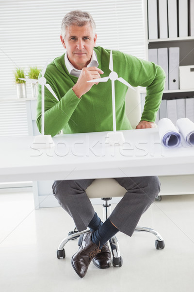Casual businessman looking at model wind turbines  Stock photo © wavebreak_media