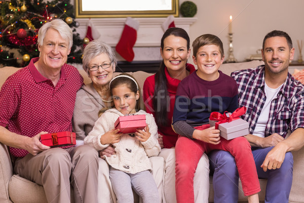 Stock photo: Happy extended family looking at camera at christmas time