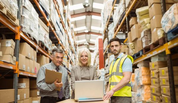 Warehouse team working together on laptop Stock photo © wavebreak_media