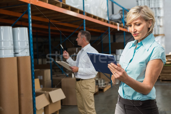 Pretty warehouse manager using tablet pc Stock photo © wavebreak_media