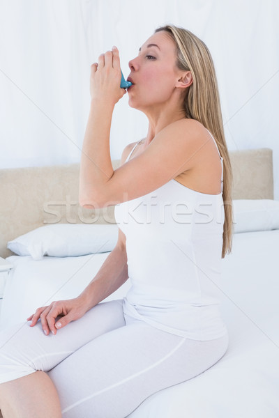 Beauty blonde using asthma inhaler Stock photo © wavebreak_media