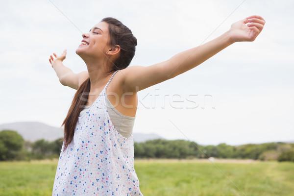 Pretty brunette feeling free in the park Stock photo © wavebreak_media