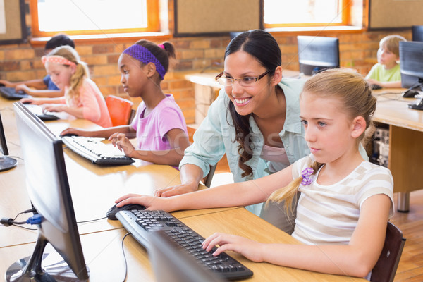Stock photo: Cute pupils in computer class with teacher