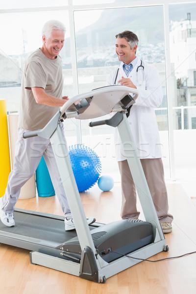 Senior man on treadmill with therapist  Stock photo © wavebreak_media