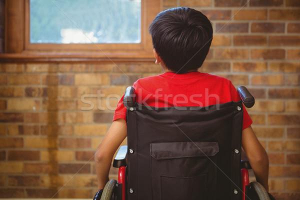 Achteraanzicht jongen vergadering rolstoel weinig school Stockfoto © wavebreak_media
