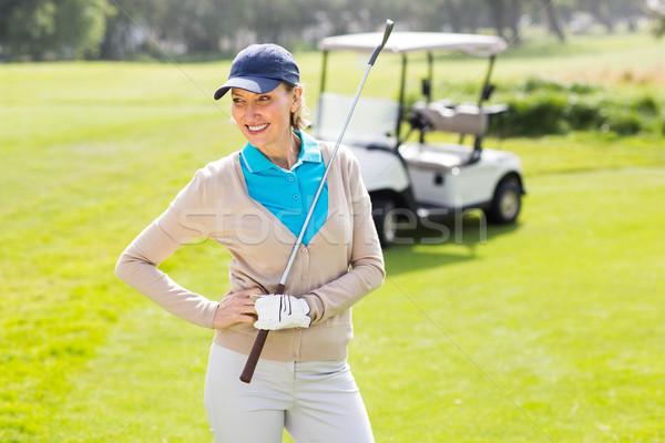 женщины гольфист улыбаясь рук бедро Сток-фото © wavebreak_media
