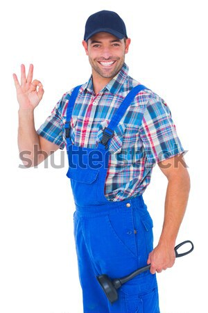 Male handyman standing arms crossed over white background Stock photo © wavebreak_media