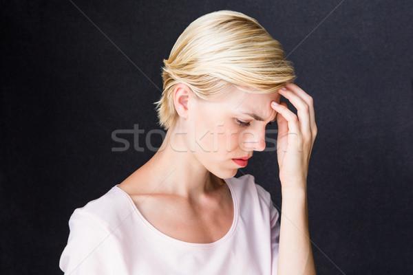 Nerveux femme blonde noir femme pense cute Photo stock © wavebreak_media