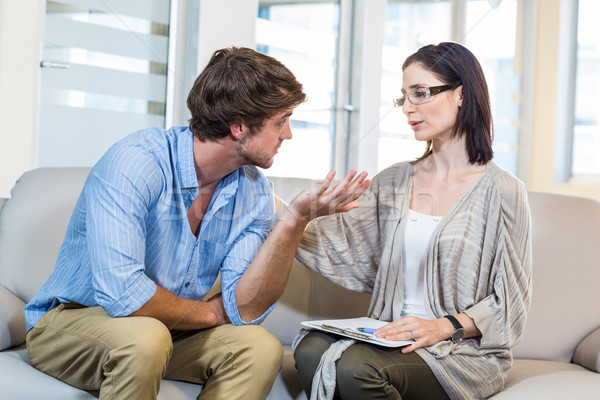 Stock photo: Psychologist comforting a depressed patient