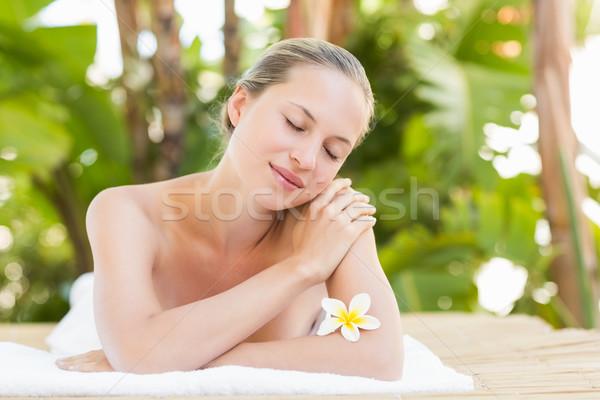Paisible serviette femme fleur Photo stock © wavebreak_media
