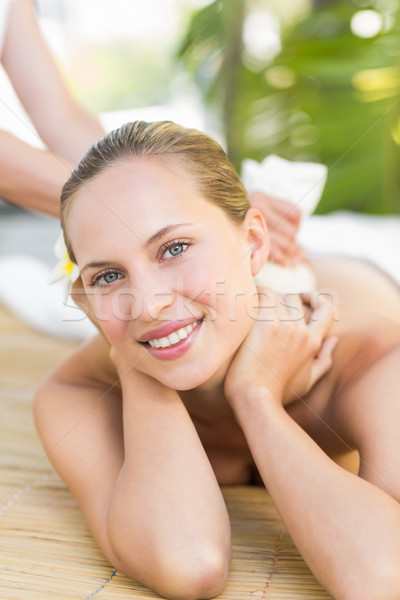 Stock photo: Attractive woman getting massage on her back