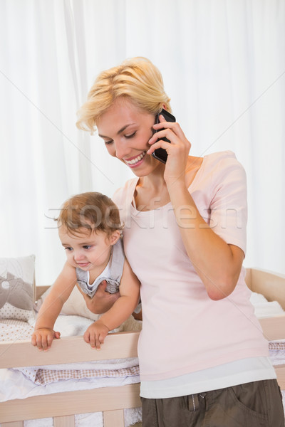 Smiling blonde woman with his son phoning  Stock photo © wavebreak_media