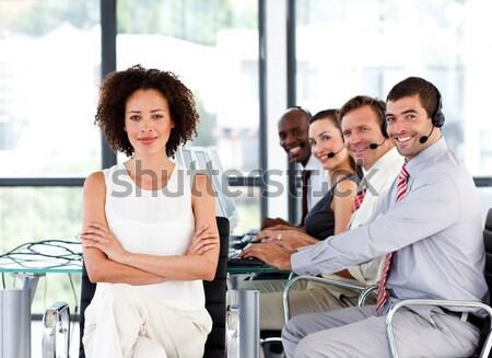 Vrouw rolstoel glimlachend camera team achter Stockfoto © wavebreak_media