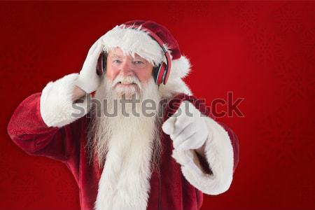 Composite image of santa is listening some music Stock photo © wavebreak_media