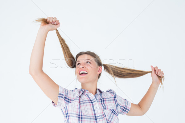 Geeky hipster holding her pigtails Stock photo © wavebreak_media