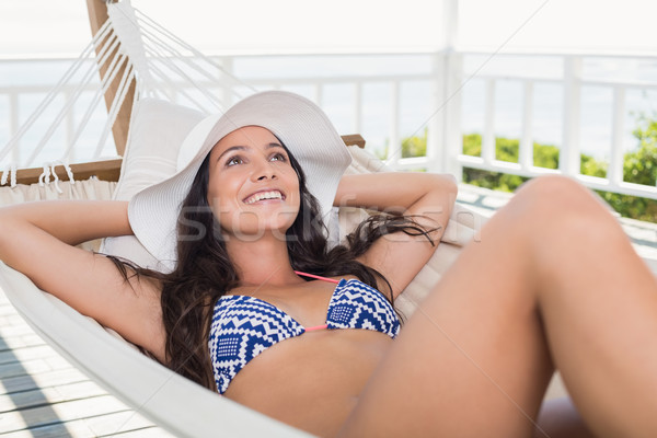 довольно брюнетка расслабляющая гамак патио Бикини Сток-фото © wavebreak_media