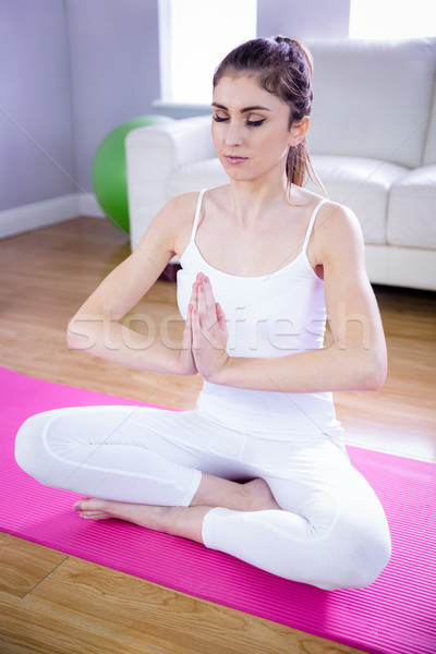 Stock photo: Fit woman doing yoga on mat