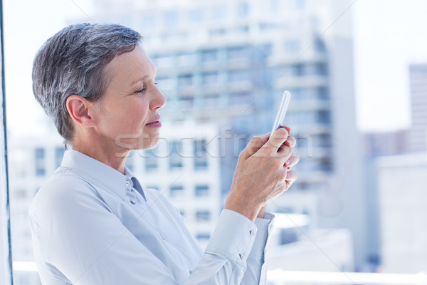 Businesswoman sending a text message Stock photo © wavebreak_media