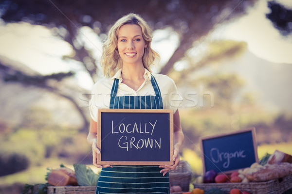 Sorridente jeans mulher crescido assinar Foto stock © wavebreak_media