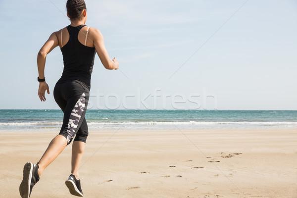 Fitt nő jogging homok tengerpart tenger Stock fotó © wavebreak_media