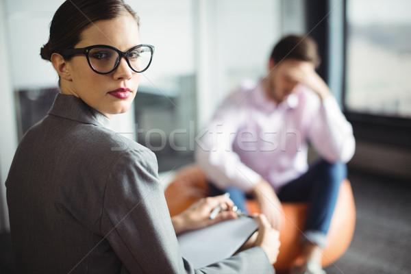 Retrato conselheiro homem caneta triste feminino Foto stock © wavebreak_media