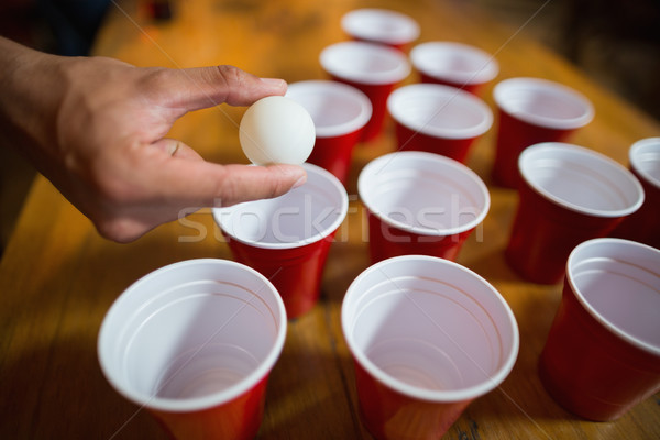 Cropped hand of man playing beer pong Stock photo © wavebreak_media