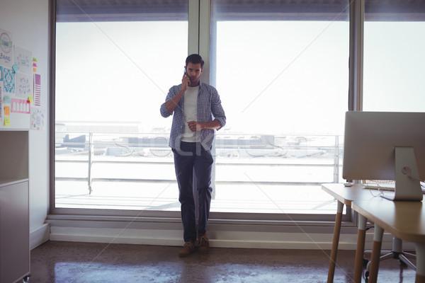 Male graphic designer talking on mobile phone in office Stock photo © wavebreak_media