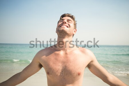 Portre gömleksiz adam ayakta plaj Stok fotoğraf © wavebreak_media