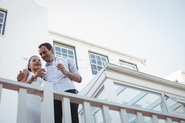 улыбаясь пару шампанского балкона домой любви Сток-фото © wavebreak_media