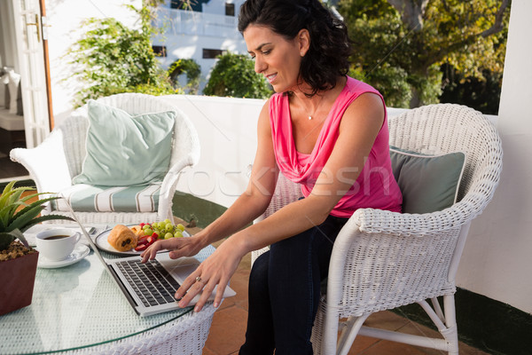 Mid adult woman using laptop in cafe Stock photo © wavebreak_media