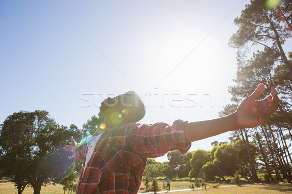 Man standing with arms outstretched in the park Stock photo © wavebreak_media