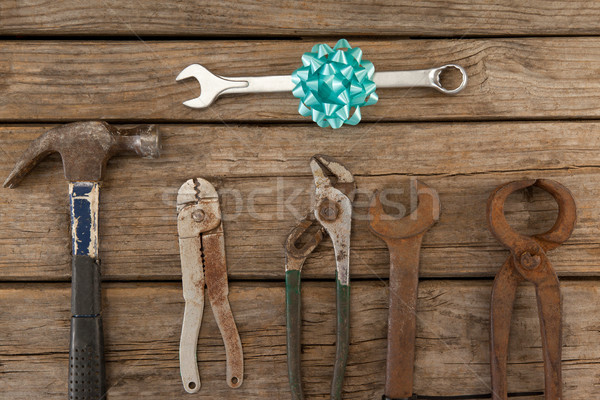 Wrench with ribbon by hand tools on wooden table Stock photo © wavebreak_media