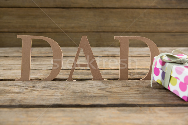 Dad text with gifts on table Stock photo © wavebreak_media